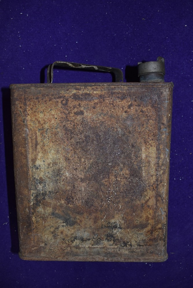 A vintage garage 1 gallon oil can for with Pratts top