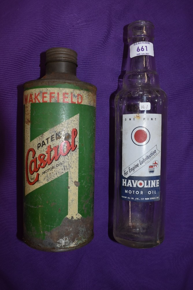 A Castrol oil tin and a Havoline motor oil bottle.