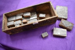 A crate containing 1950s and 60s Guy Lorry ink stamps, various models.