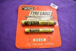 A vintage Aerite advertising card with tyre pressure gauges.