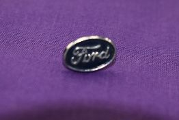 A Ford lapel badge.