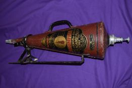 A vintage conical shaped fire extinguisher the Minimax with wall bracket