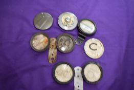 A selection of vintage motor car tax disk holders