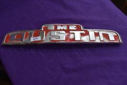 A BMC Austin cab badge.
