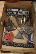 A selection of vintage garage motor car engine badges