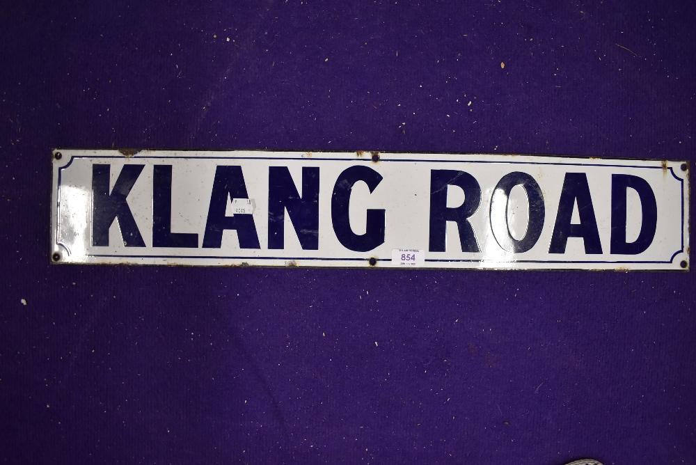 A vintage road side enamel sign reading Klang Road