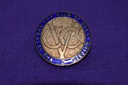 A veteran car club lapel badge.
