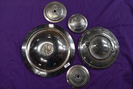 A selection of vintage motor car wheel hub caps including Ford Jaguar etc