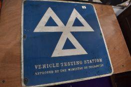 A vintage garage sign for Vehicle Testing Station Ministry of Transport