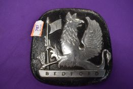 A vintage Bedford truck engine badge with gryphon emblem