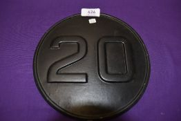 A small cast commercial 20mph rear badge