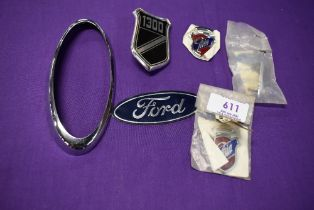 A selection of motor car engine badges for Ford Ghia