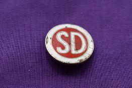A shelvoke and D badge