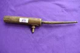 An Enots brass oil can.