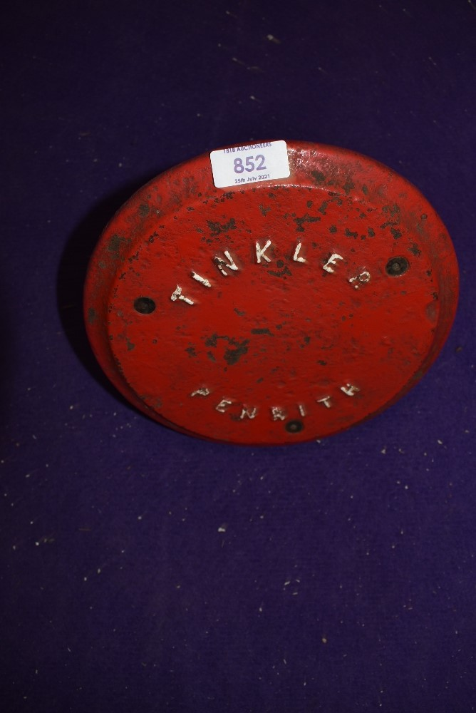 A cast iron plate cover reading Tinkler Penrith