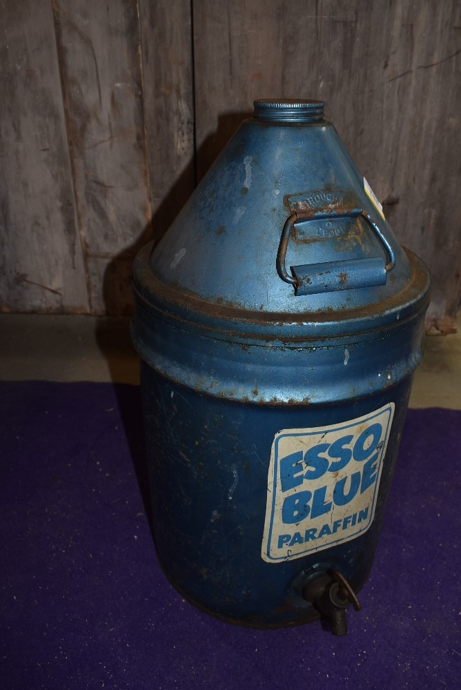 A large Esso Blue Paraffin five gallon tank with lid