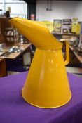 A vintage garage five litre oil can in yellow