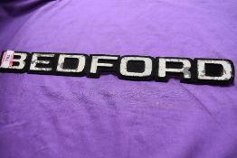 A vintage Bedford truck engine badge