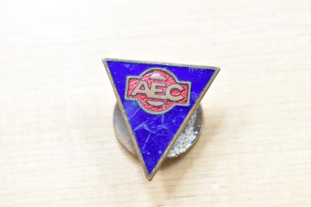 An AEC lapel badge.