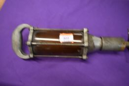 A vintage garage oil gun Non Drip Measure
