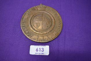 A motor car engine badge for the Commercial Motor User Association