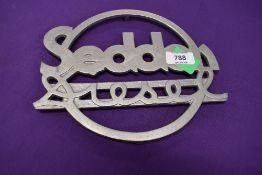 A cast metal sign for Seddon Diesel
