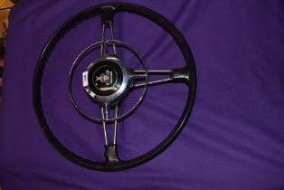 A vintage two fork steering wheel for Rover cars having horn push