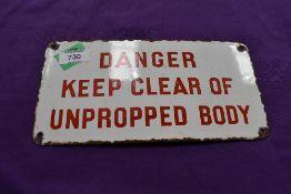 A vintage garage sign for Danger Keep Clear of Unpropped Body