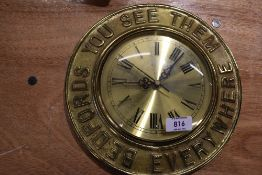 A vintage garage brass cast advertising clock for Bedford