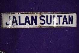 A vintage road side enamel sign reading Jalan Sultan