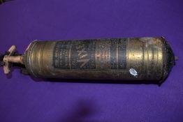 A vintage garage brass fire extinguisher for Vixen