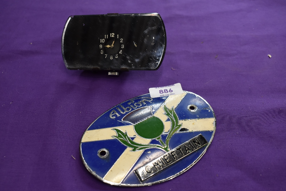 An Albion motor engine badge and a mirror back car clock