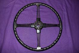 A vintage lorry or heavy goods vehicle steering wheel