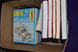 A selection of Haynes motor car instruction manuals and workshop guides including Ford and Mini