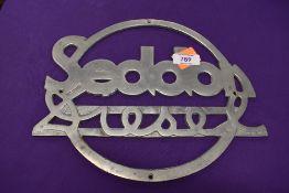 A larger cast metal sign for Seddon Diesel