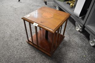 An Edwardian revolving book case with inlayed detail to top 30cm tall by 28cm wide