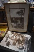 A framed photographic print of two children and another unframed one of Romany life/caravan
