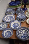 A good selection of various blue and white willow wear plates and bowls