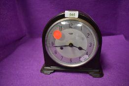 A mid century 8 day bakelite mantel clock