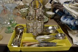 A selection of cutlery and flatware loose also condiment set
