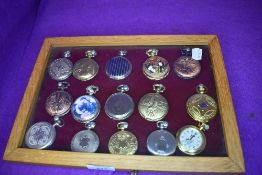 A glazed display case containing fifteen pocket watches or time pieces