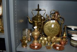 A fine selection of brass and copper items including dinner gong spirit kettle with stand and copper