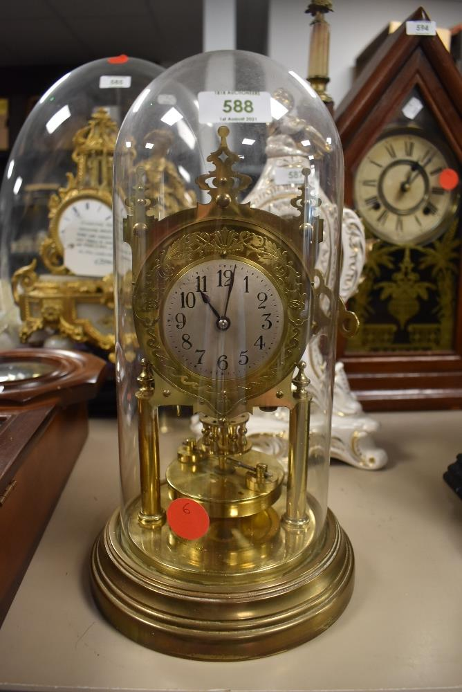 A German made anniversary clock in glass dome, Jahresumrenfabrik in gothic style