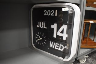 A vintage style flip chart wall clock with date time and month fully working