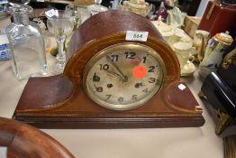 An inlaid wooden mantel clock