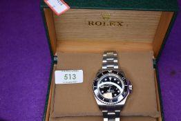 A gent's fashion wrist watch having black face bearing name Rolex