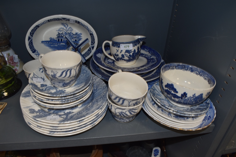 An assortment of blue and white ware including Wedgwood and Johnson Bros.