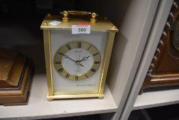 A seiko brass effect mantel clock