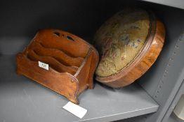 An Edwardian oak letter rack and similar antique circular footstool