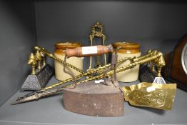 A fine selection of fire side items including brass and cast fire dogs with poker tong and shovel